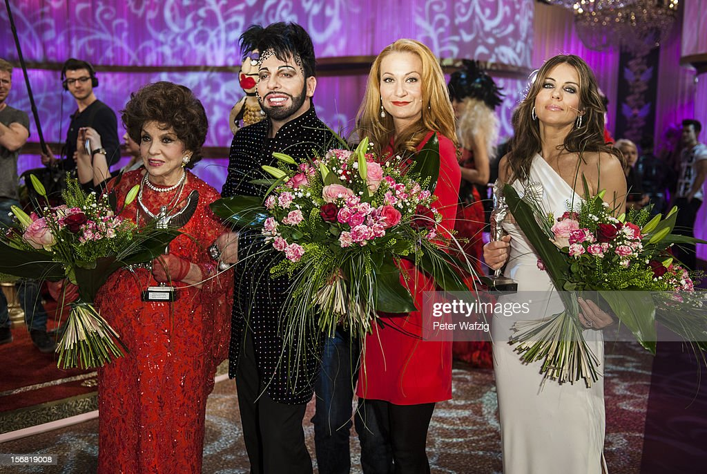 <a gi-track='captionPersonalityLinkClicked' href=/galleries/search?phrase=Gina+Lollobrigida&family=editorial&specificpeople=93465 ng-click='$event.stopPropagation()'>Gina Lollobrigida</a>, Harald Gloeoeckler, Constanze Rick and Liz Hurley attend the photocall after the 'Desastroeoes Bis Pompoeoes - Der Modische Jahresrueckblick Des Herrn Gloeoeckler' TV Show on November 21, 2012 in Cologne, Germany.