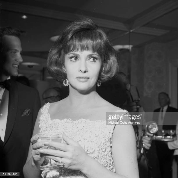 Gina Lollobrigida poses during a party in Los AngelesCA