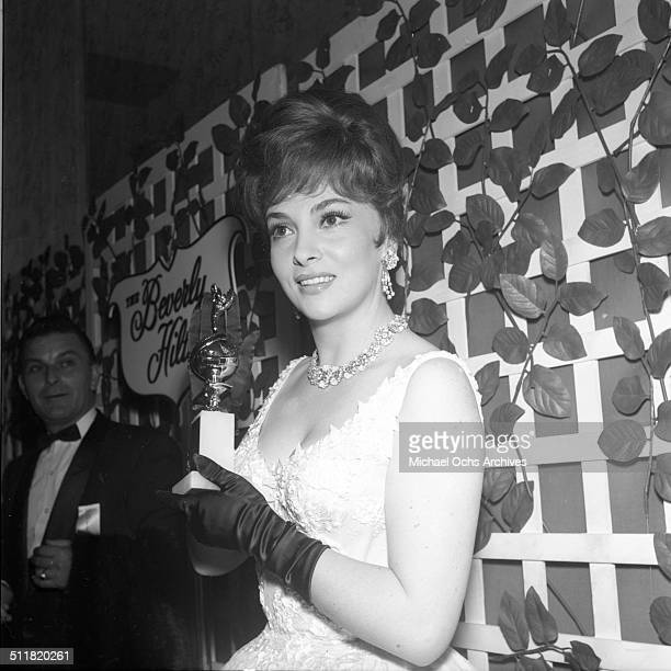 Gina Lollobrigida poses with her Golden Globe Award for 'Come September' during the Golden Globe Awards in Los AngelesCA
