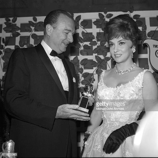 Gina Lollobrigida receives a Golden Globe Award for 'Come September' during the Golden Globe Awards in Los AngelesCA