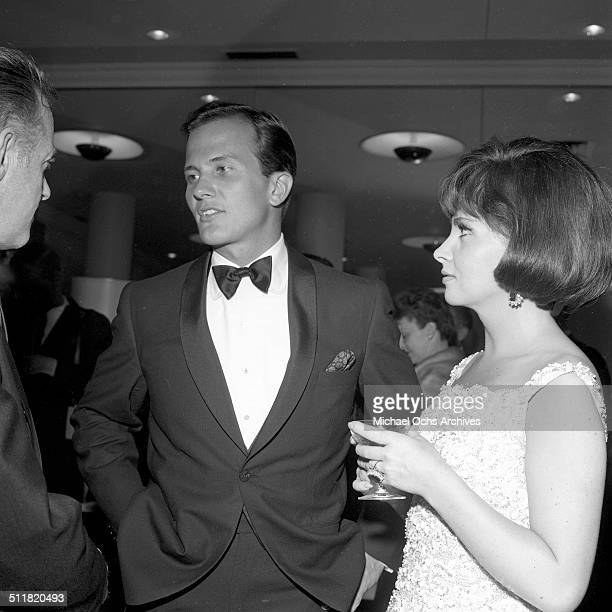 Gina Lollobrigida with Pat Boone at a party in Los AngelesCA