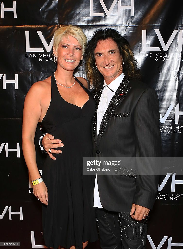 Gina McAuley (L) and her husband, singer Robin McAuley arrive at the 'Night of the Champion' event to honor former boxer Leon Spinks hosted by the cast members of 'Raiding the Rock Vault' at The Las Vegas Hotel & Casino on August 17, 2013 in Las Vegas, Nevada.