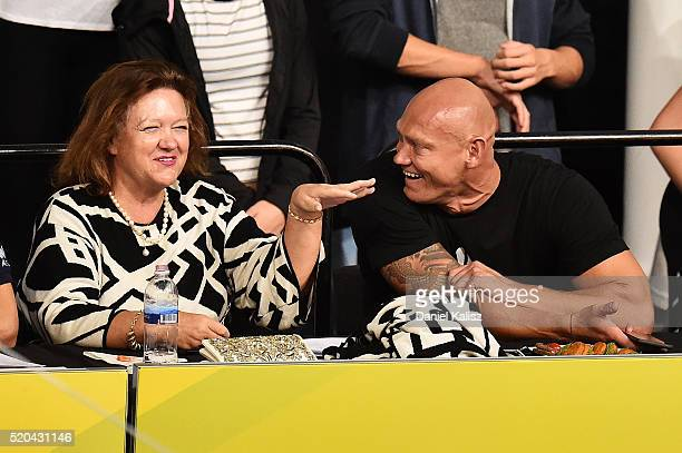 Gina Rinehart speaks to Michael Klim during day five of the Australian Swimming Championships at the South Australian Aquatic Leisure Centre on April...