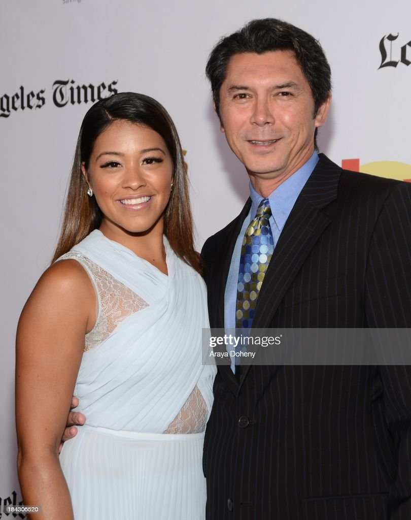 Gina Rodriguez and Lou Diamond Phillips attend the 2013 Latinos de Hoy Awards at Los Angeles Times' Chandler Auditorium on October 12, 2013 in Los Angeles, California.