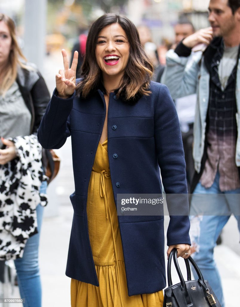 Gina Rodriguez flashed big smiles and a peace sign to fans in NYC on Monday.