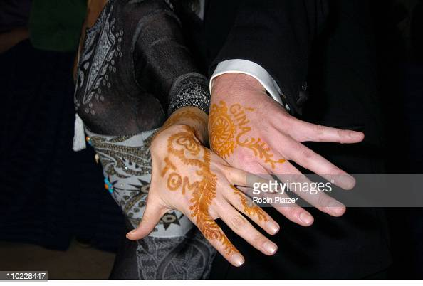 Gina Tognoni and Tom Pelphrey showing off henna tattoos of each others names
