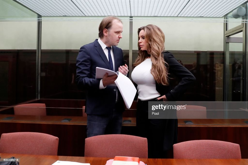 Gina-Lisa Lohfink speaks with her lawyer Burkhard Benecken during her appeal hearing at the Tiergarten regional court on February 10, 2017 in Berlin, Germany. The 29-year-old model Gina-Lisa Lohfink appealed the decision against her. She was ordered to pay a 24,000 EUR fine in January 2016, when the Amtsgericht Tiergarten court in Berlin ruled that she had falsely accused two men of raping her, after a video of a sexual encounter with them surfaced on the Internet in 2012.