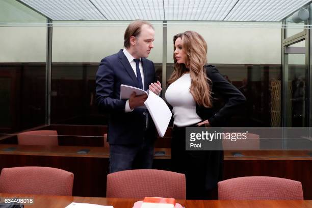GinaLisa Lohfink speaks with her lawyer Burkhard Benecken during her appeal hearing at the Tiergarten regional court on February 10 2017 in Berlin...