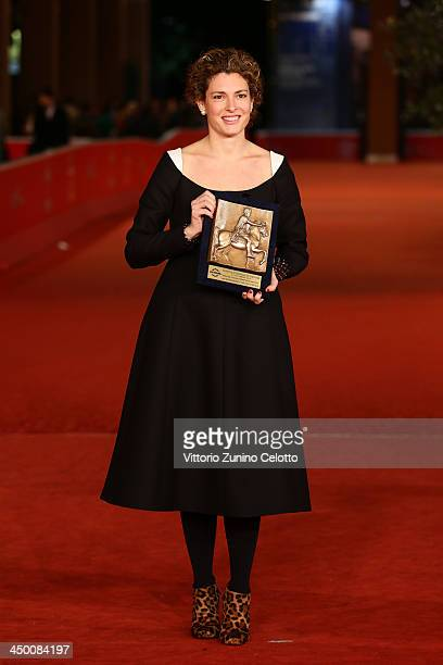 Ginevra Elkann poses with an award she received on behalf of the winner as she attends the Award Winners Photocall during the 8th Rome Film Festival...