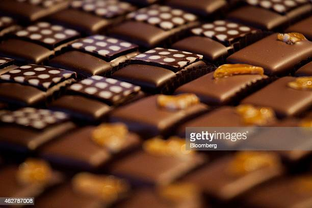 Ginger and dulce de leche flavored chocolate pieces are displayed for sale in the retail space at the Theo Chocolate factory in Seattle Washington US...
