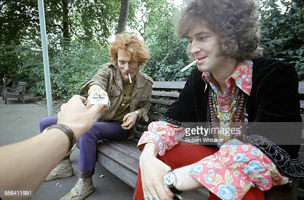 Ginger Baker and Eric Clapton of Cream pictured smoking on a park bench London May 1967