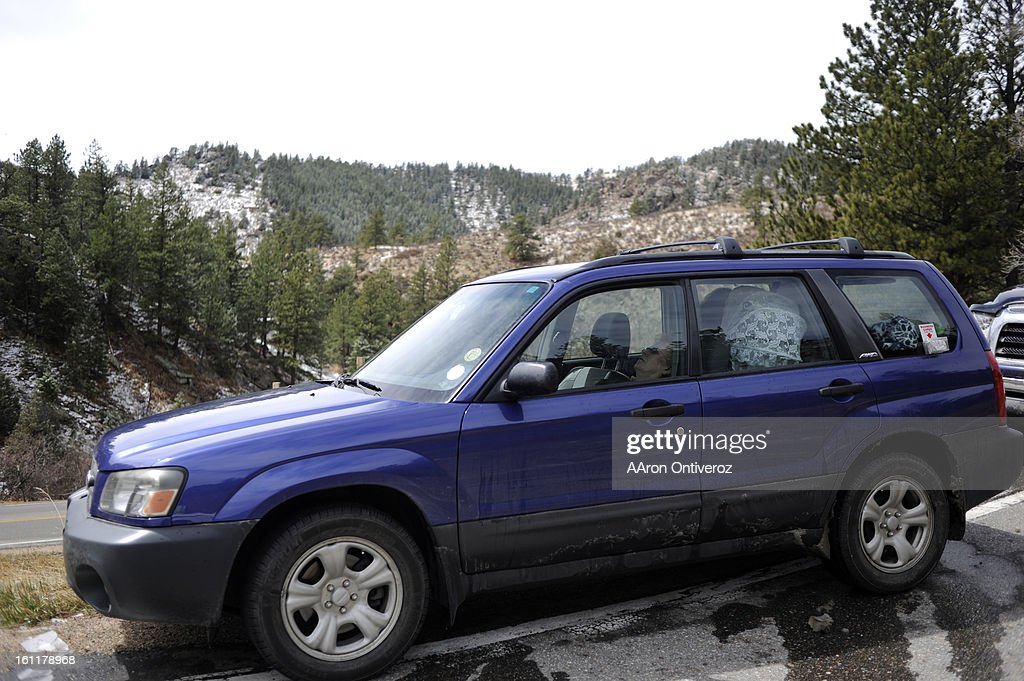 Ginger Borgeson sleeps in her vehicle at a road block in Buckhorn Canyon during the Crystal Mountain fire on Sunday, April 3, 2011. Borgeson said she was evacuated at around 12:30 a.m. when the fire grew from some 20 acres to more than 2,000 during the night. 'Better safe than sorry,' she said. 'I'd rather have 'em being concerned about us.' AAron Ontiveroz, The Denver Post