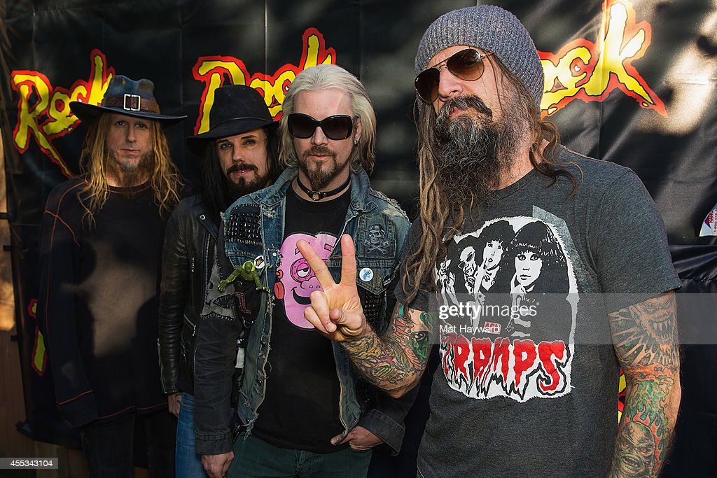 Ginger Fish Piggy D John 5 and Rob Zombie pose for a photo backstage at White River Amphitheater on September 12 2014 in Enumclaw Washington