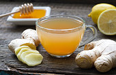 Ginger homemade tea infusion on wooden board with lemon still life