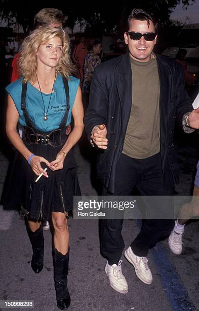 Ginger Lynn Allen and Charlie Sheen attend Second Annual Reid Rondell Stunt Foundation Party on October 6 1990 at Saugas Speedway in Saugas California
