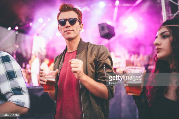 Ginger man enjoying in beer and music