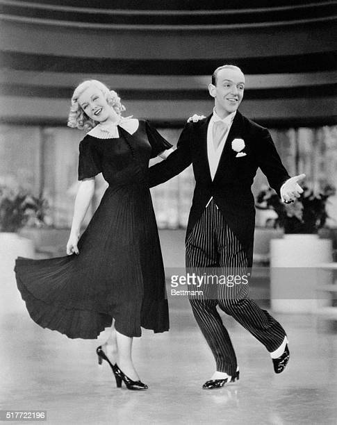 Ginger Rogers plays Penelope 'Penny' Carroll and Fred Astaire plays John 'Lucky' Garnett in the musical number 'Pick Yourself Up' in the 1936 film...