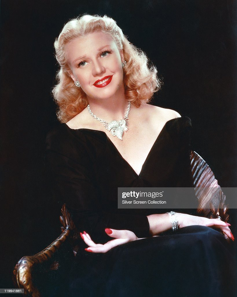 <a gi-track='captionPersonalityLinkClicked' href=/galleries/search?phrase=Ginger+Rogers&family=editorial&specificpeople=93466 ng-click='$event.stopPropagation()'>Ginger Rogers</a> (1911-1995), US actress and dancer, wearing a low-cut V-neck outfit, with an ornate silver necklace, in a studio portrait, against a black background, circa 1945.