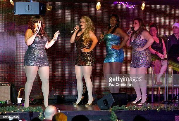 Ginger Snap Caramella Candy Apple and Lady Finger of the band Glamazons perform at SPARKLE An All Star Holiday Concert to benefit the Actors' Fund at...