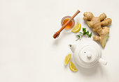 Ginger tea ingredients concept, healthy comforting and heating tea under simple recipe, view from above, space for a text
