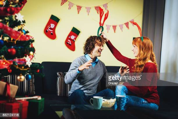 Ginger woman at home for Christmas with her boyfriend