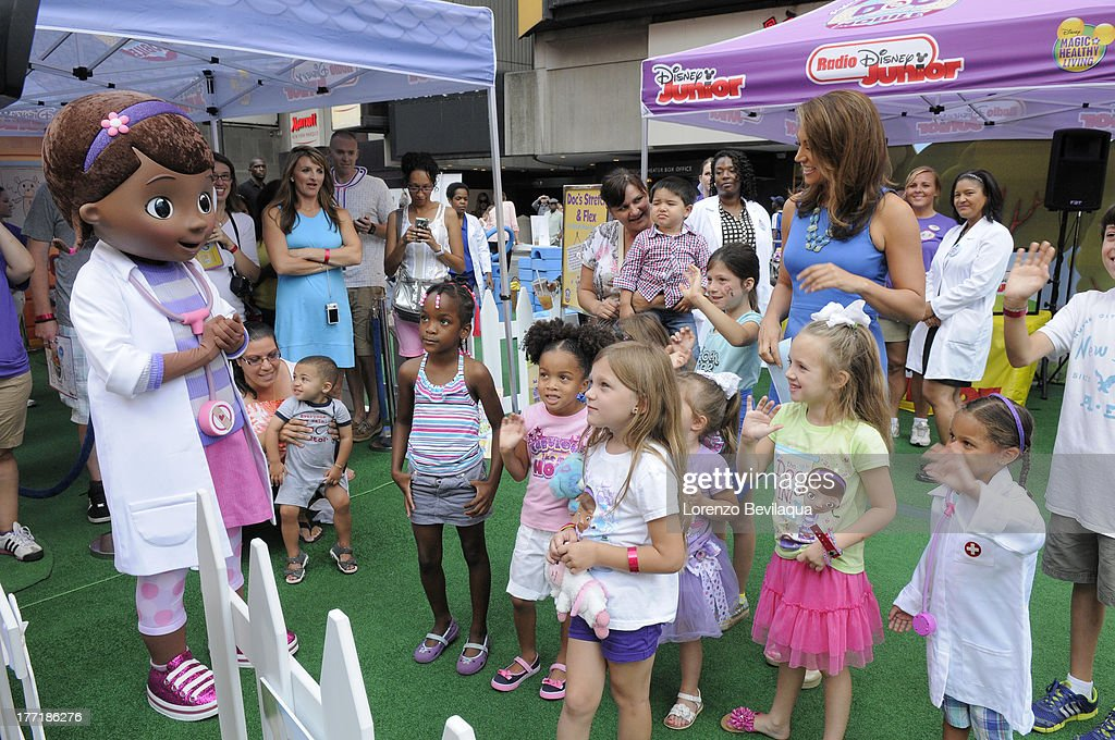 DOC MCSTUFFINS - Ginger Zee of GOOD MORNING AMERICA visits The Doc Mobile, an interactive, health-focused tour based on Disney Junior's acclaimed animated series 'Doc McStuffins' made a stop in front of New York's Times Square Disney Store on Wednesday, August 21, bringing empowering experiences relating to health and nutrition to kids and families in attendance. (Photo by Lorenzo Bevilaqua/Disney Junior via Getty Images) GINGER