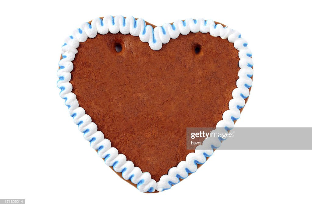 A gingerbread cookie in the shape of a heart