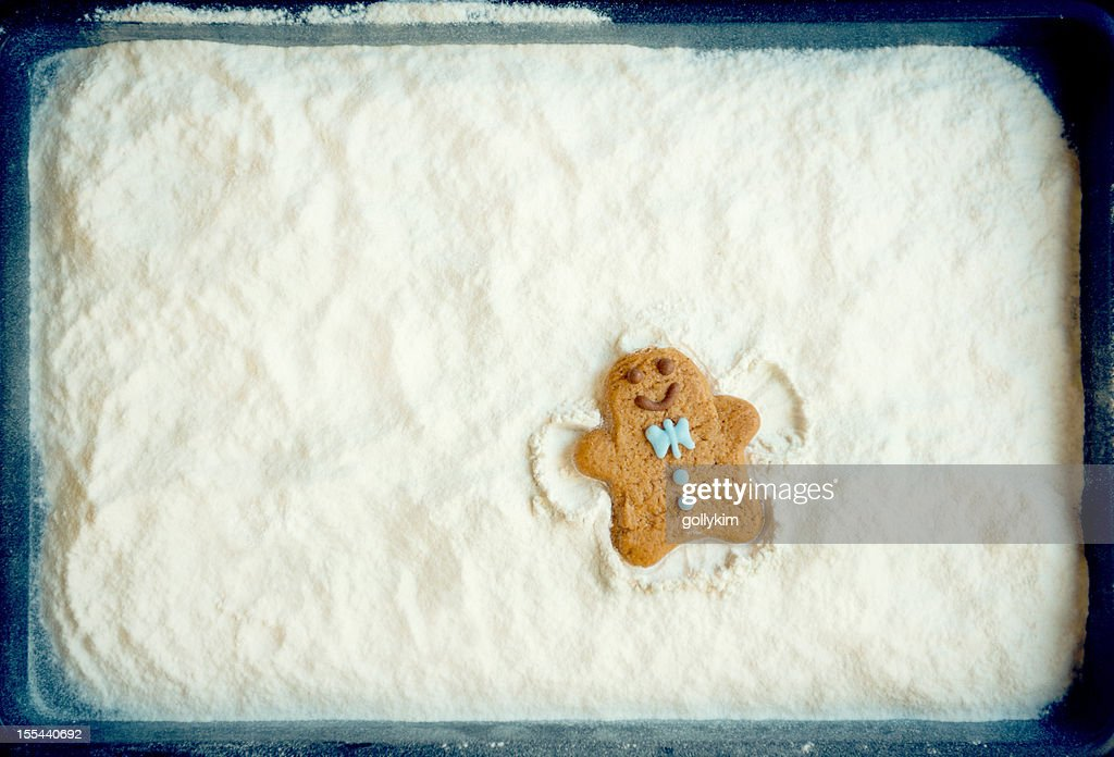 Gingerbread Cookie Man Making Snow Angel Stock Photo | Getty Images