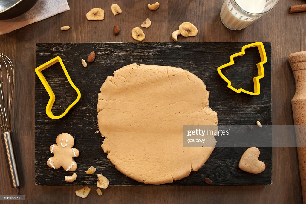 Gingerbread dough with cookies and culinary forms : Stock Photo