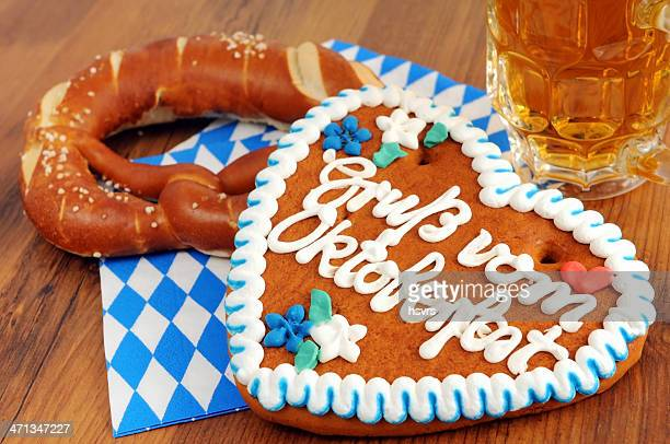 Gingerbread heart and pretzel on a napkin next to a mug