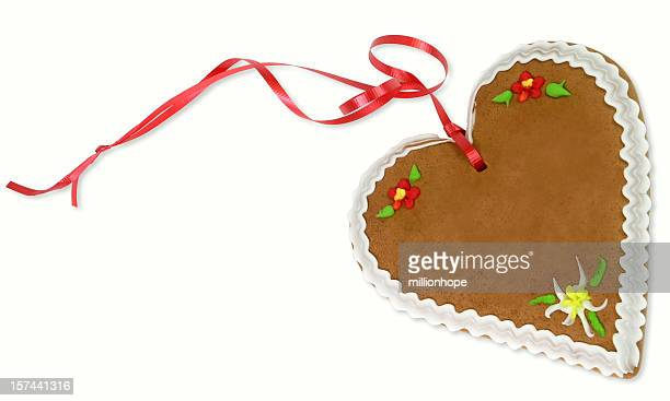 A gingerbread heart with red ribbon attached