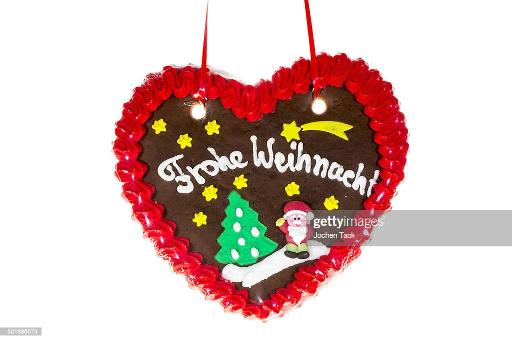 gingerbread heart with the writing frohe weihnachten. Black Bedroom Furniture Sets. Home Design Ideas