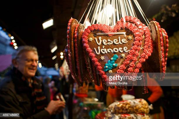 Gingerbread hearts saying 'Merry Christmas' are displayed at the Christmas market at the Old Town Square on November 30 2014 in Prague Czech Republic...