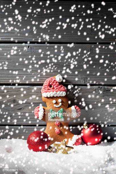 Gingerbread man and Christmas bubbles with rippling artificial snow in front