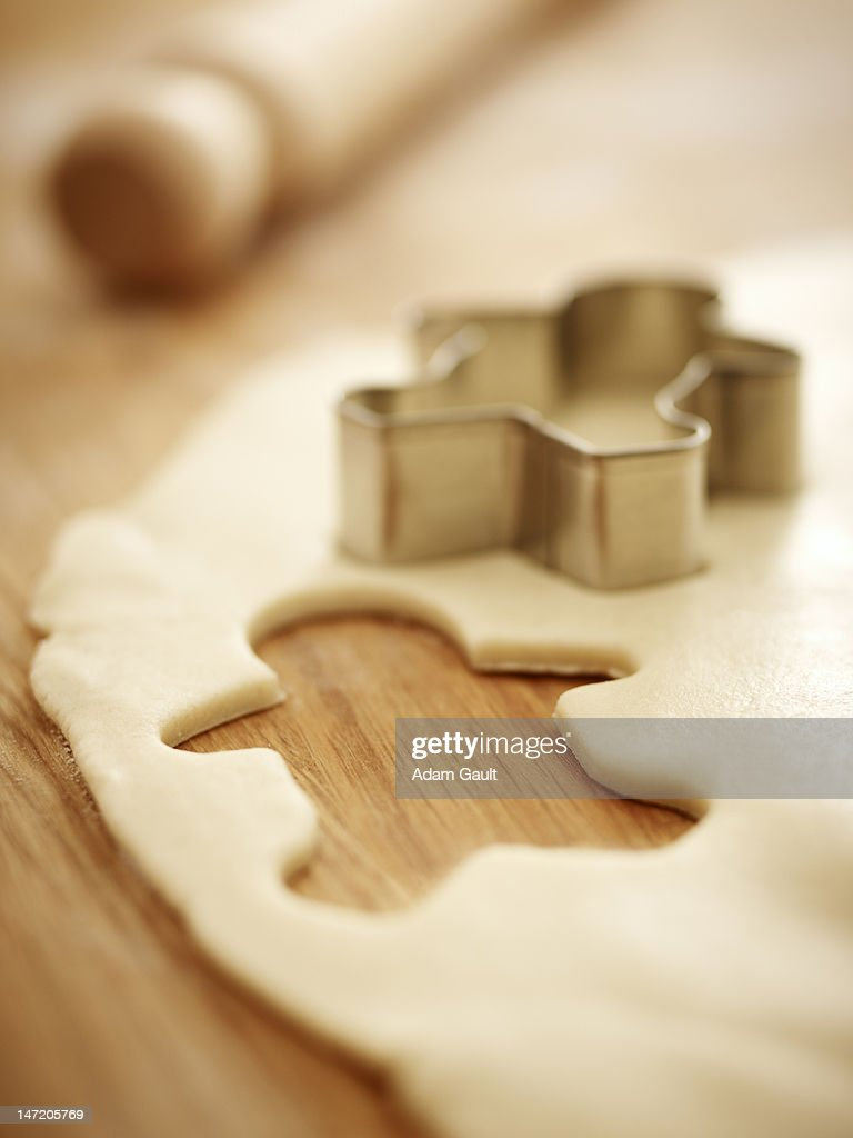 Gingerbread man cookie cutter on dough : Stock Photo