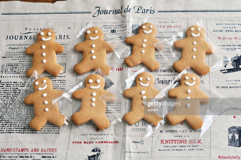 Gingerbread men on newspaper