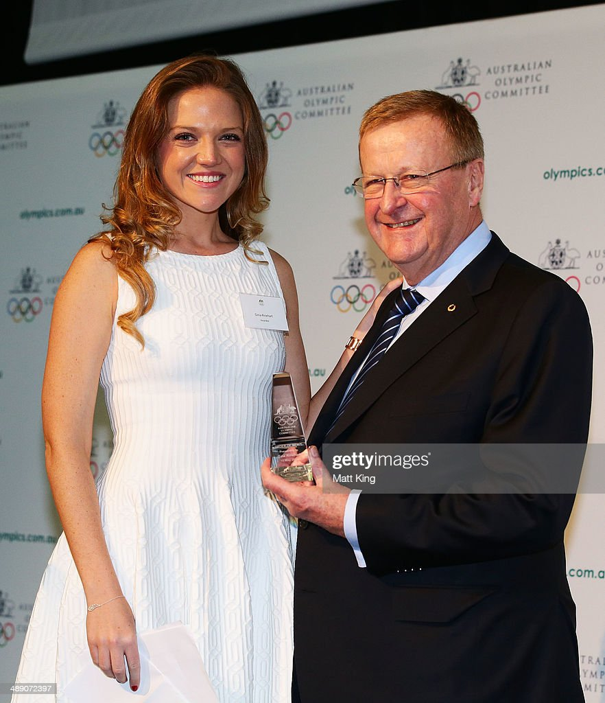 Ginia Rinehart accepts the AOC Order of Merit Award on behalf of her mother Ginia Rinehart from AOC President <a gi-track='captionPersonalityLinkClicked' href=/galleries/search?phrase=John+Coates&family=editorial&specificpeople=233445 ng-click='$event.stopPropagation()'>John Coates</a> during the Australian Olympic Committee Annual General Meeting at Museum of Contemporary Art on May 10, 2014 in Sydney, Australia.