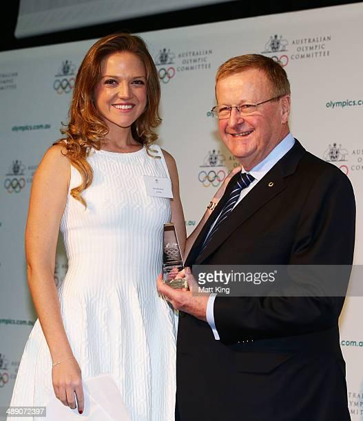 Ginia Rinehart accepts the AOC Order of Merit Award on behalf of her mother Ginia Rinehart from AOC President John Coates during the Australian...