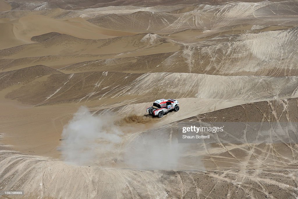 Giniel De Villiers and co-driver Dirk Von Zitzewitz of team Toyota compete in stage 6 from Arica to Calama during the 2013 Dakar Rally on January 10, 2013 in Arica, Chile.