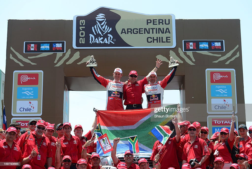 Giniel De Villiers and co-driver Dirk Von Zitzwitz of team Toyota, 2nd place in Autos, celebrate during the podium presentations at the end of the 2013 Dakar Rally on January 20, 2013 in Santiago, Chile.
