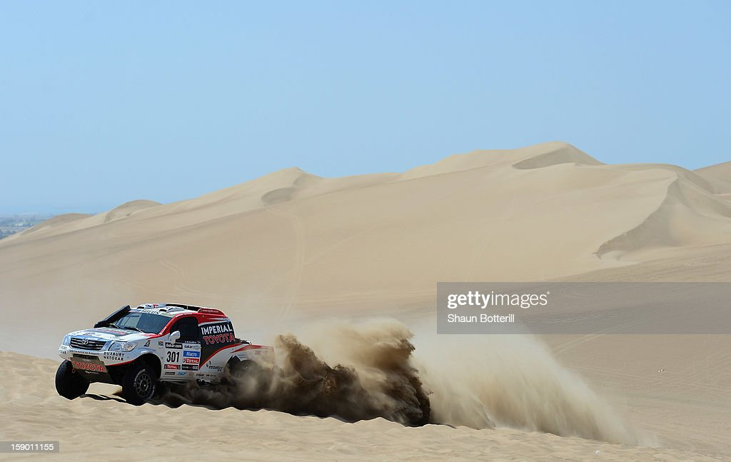 Giniel De Villiers and co-pilot Dirk Von Zitzewitz of team Toyota compete during the special stage of day one of the of the 2013 Dakar Rally on January 5, 2013 in Pisco, Peru.
