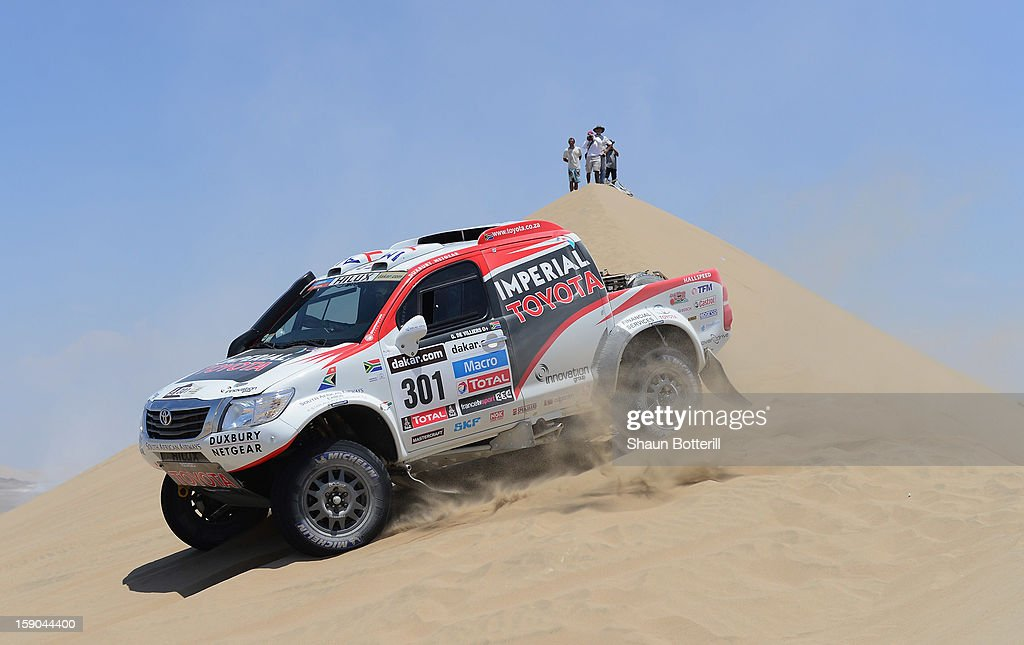 Giniel De Villiers and co-pilot Dirk Von Zitzewitz of team Toyota compete during the stage from Pisco to Pisco on day two of the 2013 Dakar Rally on January 6, 2013 in Pisco, Peru.