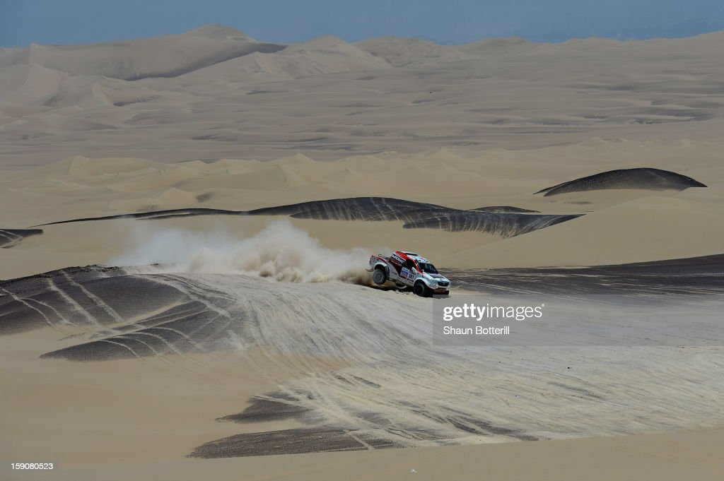 Giniel De Villiers and co-pilot Dirk Von Zitzewitz of team Toyota compete during the stage from Pisco to Nazca on day three of the 2013 Dakar Rally on January 7, 2013 in Pisco, Peru.