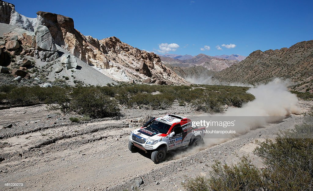Giniel De Villiers of South Africa and Dirk Von Zitzewitz of Germany for Imperial Toyota compete on Day 3 of the Dakar Rally 2014 on January 7, 2014 in Uspallata, Argentina.