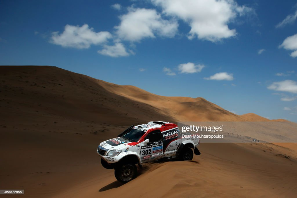 Giniel De Villiers of South Africa and Dirk Von Zitzewitz of Germany for Imperial Toyota compete in stage 12 on the way to La Serena during Day 13 of the 2014 Dakar Rally on January 17, 2014 in El Salvador, Chile.