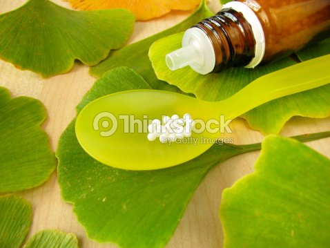 Ginkgo and homeopathic pills : Stock Photo