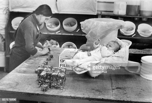 Ginnv Bell wraps Chews a fruitnut sugarless candy bar made by White Wave Baby is manager's son 3monthold Emmet Demas Credit Denver Post