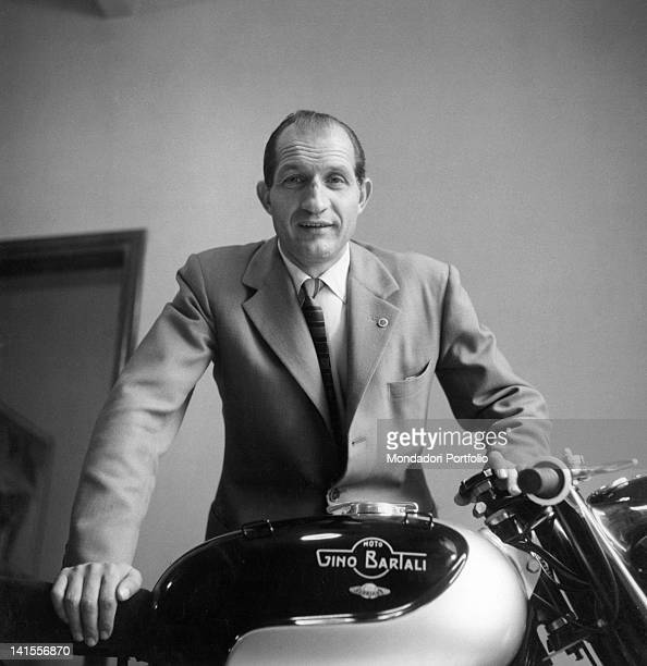 Gino Bartali in the saddle of the motorcycle that bears his name Florence October 1955