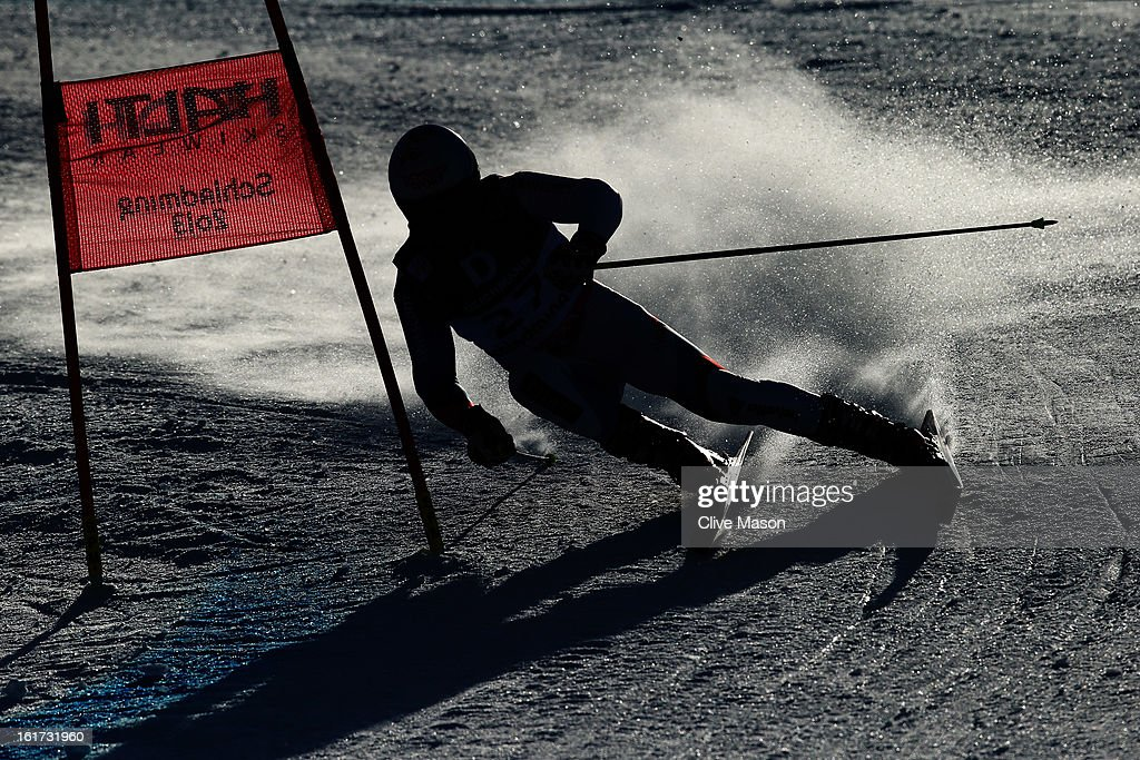Gino Caviezel of Switzerland skis in the Men's Giant Slalom during the Alpine FIS Ski World Championships on February 15, 2013 in Schladming, Austria.