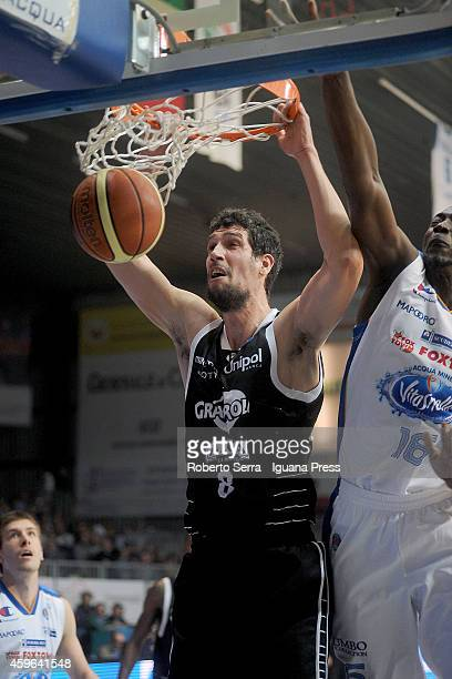 Gino Cuccarolo of Granarolo competes with Cheikh Mbodj of Acqua Vitasnella looks over during the LegaBasket Serie A1 match between Acqua Vitasnella...